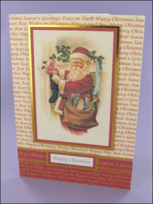 Santa filling Stocking Christmas card